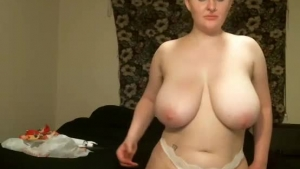 Mature blonde seductress with big boobs